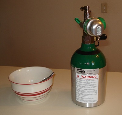 My oxygen tank next to my favorite cereal bowl for scale.